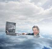 Businessman swimming in the water Stock Photography