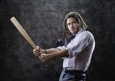 Businessman swinging baseball bat Royalty Free Stock Photo