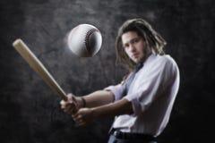 Businessman swinging baseball bat Stock Photos