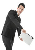 Businessman swinging his laptop Royalty Free Stock Photo
