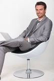 Businessman in a swivel chair Royalty Free Stock Photos