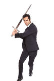Businessman with a sword Royalty Free Stock Photography
