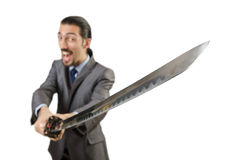 Businessman with sword. On white stock photos
