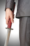 Businessman with sword Stock Photography