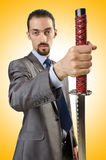 Businessman with sword Royalty Free Stock Images