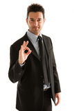 Businessman symbol OK. Men dress elegant indicating OK with the hand Royalty Free Stock Photo