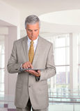 Businessman with Table Computer Stock Image