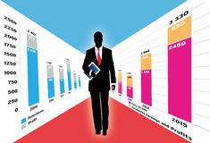 Businessman with tablet in charts world. Businessman holding a computer tablet and walking through spreadsheet data and business charts. Additional vector file Royalty Free Stock Image