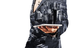 Businessman with Tablet and City Stock Photo
