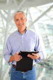 Businessman with Tablet Computer Royalty Free Stock Images