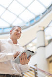 Man with tablet computer in modern business building Stock Photos