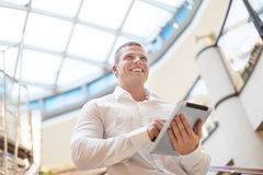 Businessman with tablet computer in modern building Stock Images