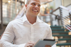 Man with tablet computer in modern business building Royalty Free Stock Photos