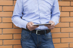 Businessman with tablet computer in the hands of the street. Royalty Free Stock Photos