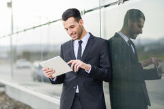 Businessman with tablet computer in office building Royalty Free Stock Images