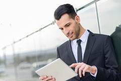 Businessman with tablet computer in office building Stock Photography