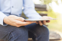 Businessman With Tablet Computer in park Royalty Free Stock Images