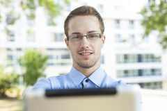 Businessman With Tablet Computer in park Stock Image