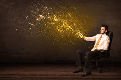 Businessman with tablet and energy explosion on background Royalty Free Stock Images