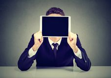 Businessman with tablet instead of face royalty free stock images