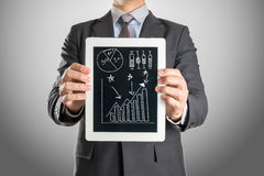 Businessman with tablet investment graph Stock Images