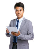 Businessman with tablet Royalty Free Stock Images
