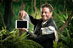 Businessman with tablet in the jungle Royalty Free Stock Photo