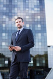 Businessman with tablet Royalty Free Stock Image