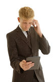 Businessman with tablet and mobilephone Royalty Free Stock Photos