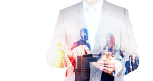 Businessman with tablet multiexposure Stock Photography