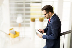 Businessman with tablet in office Royalty Free Stock Image