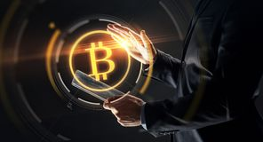 Businessman with tablet pc and bitcoin hologram Stock Images