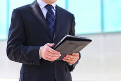 Businessman with a tablet PC Stock Images