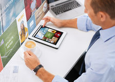 Businessman with tablet pc and coffee in office Royalty Free Stock Photo