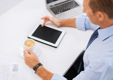 Businessman with tablet pc and coffee in office Royalty Free Stock Image