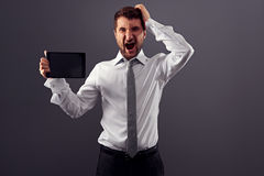 Businessman with tablet pc have a problems Stock Photo