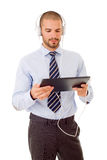 Businessman. With tablet pc and headphones, isolated Royalty Free Stock Photography