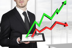 businessman tablet pc line graph Stock Images
