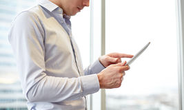 Businessman with tablet pc in office Royalty Free Stock Photo