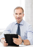 Businessman with tablet pc in office Royalty Free Stock Images