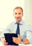 Businessman with tablet pc in office Royalty Free Stock Photos