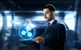 Businessman with tablet pc and ripple hologram. Business, cryptocurrency and future technology concept - close up of businessman with transparent tablet pc Stock Photos