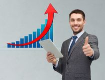 Businessman with tablet pc showing thumbs up Stock Photos