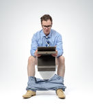 Businessman with tablet pc sitting on the toilet Stock Photo