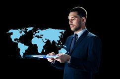 Businessman with tablet pc and world map Royalty Free Stock Images