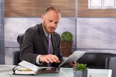 Businessman with tablet and personal organizer Royalty Free Stock Photo