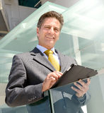 Businessman with tablet Stock Images