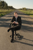Businessman with tablet on road Royalty Free Stock Photo