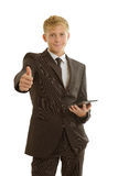 Businessman with tablet shows thumb up Royalty Free Stock Images