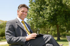 Businessman with tablet Stock Photos